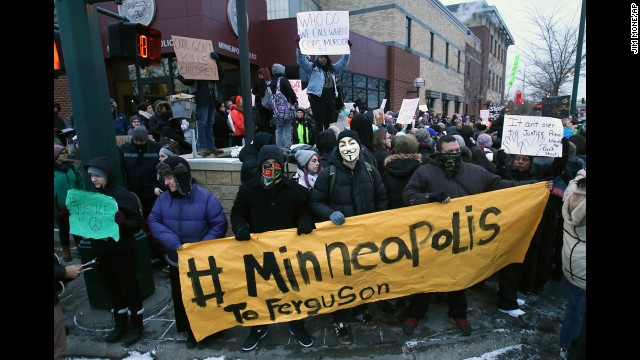 Demonstrators gather November 25 outside the Minneapolis Police Department's Third Precinct.