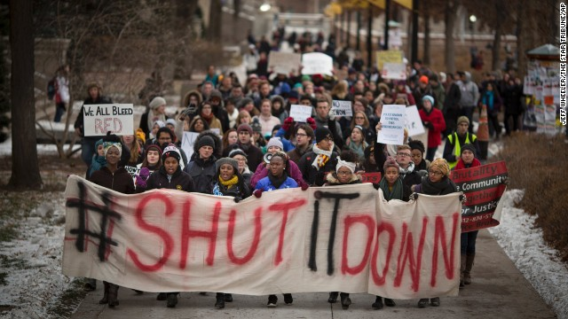 Students at the University of Minnesota in Minneapolis rally in support of police brutality victims on November 25.