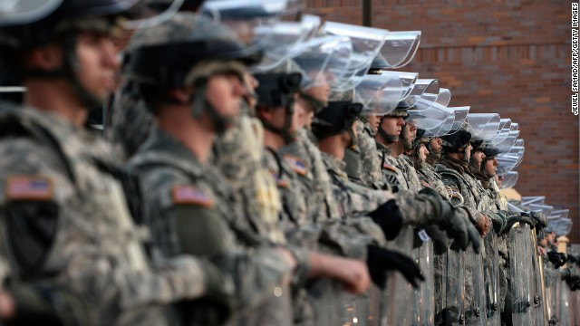 National Guard troops secure the police station in Ferguson on November 25.