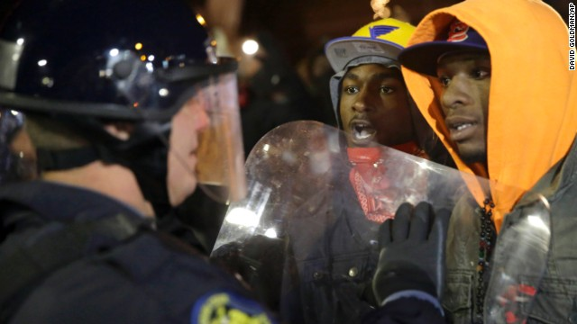 Protesters face off against a police officer on November 25.