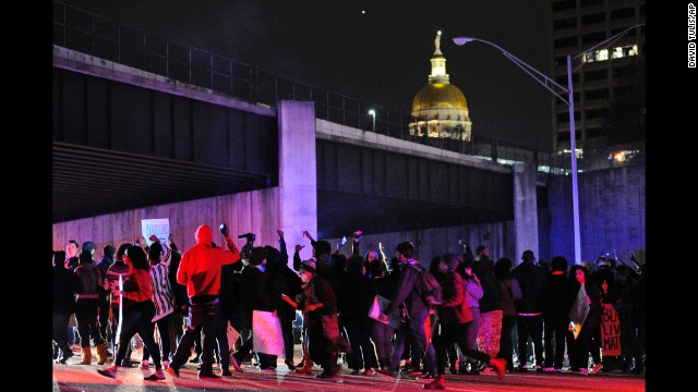 Protesters in Atlanta block all northbound lanes of Interstate 75/85 near the Georgia state Capitol on November 25.