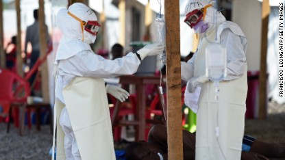Ebola team dumps bodies in pay protest