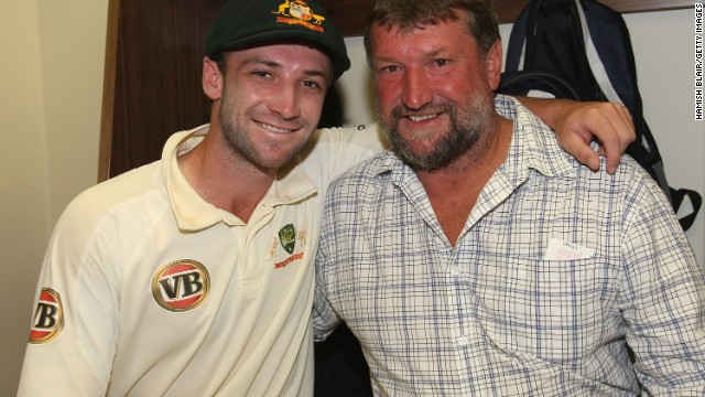 Hughes, whose mother and sister were present at the Sydney Cricket Ground when he suffered his devastating blow, celebrates victory with father Greg following his Test debut with Australia in 2009.