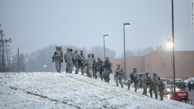 National Guard troops, who were called up by Gov. Jay Nixon to help maintain order, help with security at the mall on Wednesday, November 26.