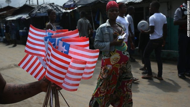 A street vendor sells Liberian flags near an Ebola isolation ward on August 15, 2014 in the country's capital of Monrovia.