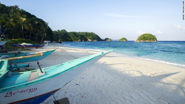 The small secluded beach is an escape from the popular White Beach. During off season -- November to April, it's lined with colorful fishing boats under repair.