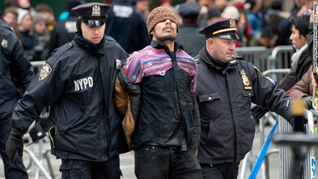 A protester is arrested in New York during the Macy's Thanksgiving Day Parade on Thursday, November 27.