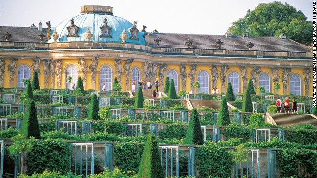 The Sanssouci Palace is a Rococo villa with a grand, terraced vineyard to the south and sweeping views of the surrounding countryside.