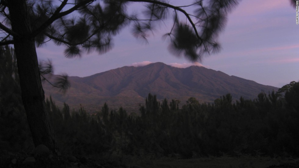 The sun rises over the mountains in <a href='http://ireport.cnn.com/docs/DOC-790142'>Davao</a>, Philippines.