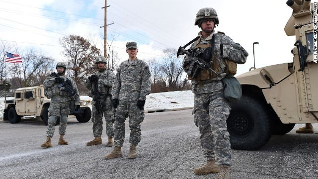 Members of the National Guard man a checkpoint at a Ferguson shopping mall on November 27.