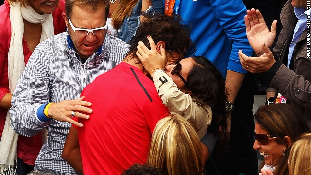 Nadal and his longtime girlfriend make a rare public display of affection at the French Open.