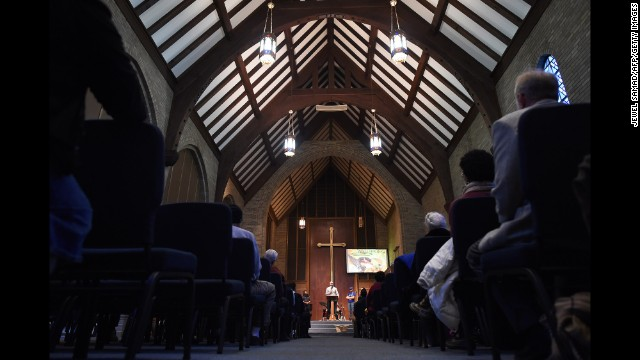 The Rev. Carlton Lee of Flood Christian Church, which was torched in the wake of the grand jury's decision in the Michael Brown shooting, speaks during a Thanksgiving service at Wellspring Church in Ferguson, Missouri, on Thursday, November 27.