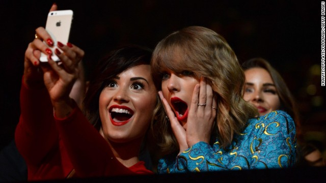 Recording artists Demi Lovato, left, and Taylor Swift take a selfie at the MTV Video Music Awards on Sunday, August 24. Lovato <a href='http://instagram.com/p/sGsETpOKp6/?modal=true' target='_blank'>posted the selfie</a> to her Instagram account.