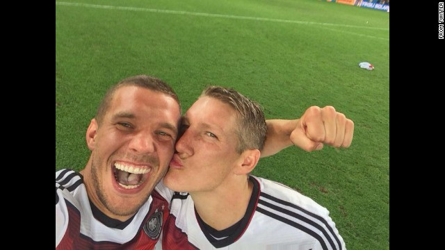 German soccer player Lukas Podolski <a href='https://twitter.com/Podolski10/status/488445583104155648/photo/1' target='_blank'>gets a kiss</a> from teammate Bastian Schweinsteiger as they celebrate their World Cup victory Sunday, July 13, in Rio de Janeiro. <a href='http://www.cnn.com/2014/07/13/worldsport/gallery/world-cup-final-germany-argentina-2014/index.html'>Germany defeated Argentina 1-0 in extra time</a> for the country's fourth World Cup title.