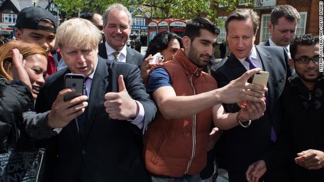 "London Mayor Boris Johnson, third from left, and British Prime Minister David Cameron, third from right, take selfies with locals as they campaign in London on Monday, May 12. Cameron <a href='http://www.standard.co.uk/news/politics/david-cameron-selfie-craze-makes-campaigning-take-a-lot-longer-9361937.html' target='_blank'>told the London Evening Standard</a> that the selfie craze these days makes campaigning take longer. ""You can be walking down the street for a chat, but until you've got the selfie out of the way people aren't ready to talk,"" he said."