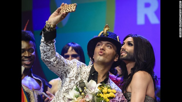 German actor Julian Stoeckel takes a selfie with Austrian singer Conchita Wurst, right, during a gala in Berlin on Friday, June 20. Wurst, the onstage drag persona of Thomas Neuwirth, won this year's <a href='http://www.cnn.com/2014/05/11/world/europe/eurovision-ukraine-russia-conchita-wurst/index.html'>Eurovision Song Contest.</a>