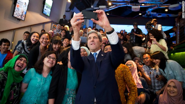 U.S. Secretary of State John Kerry takes a selfie with a group of students in Jakarta, Indonesia, before delivering <a href='http://www.cnn.com/2014/02/16/politics/kerry-climate/index.html'>a speech on climate change</a> on Sunday, February 16.