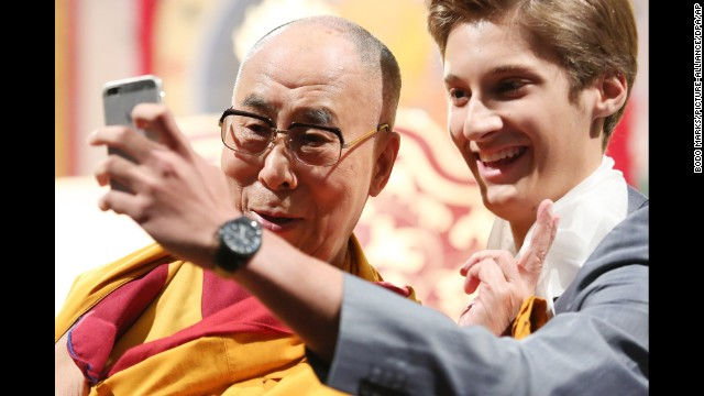 The Dalai Lama poses for a selfie during an event in Hamburg, Germany, on Sunday, August 24.