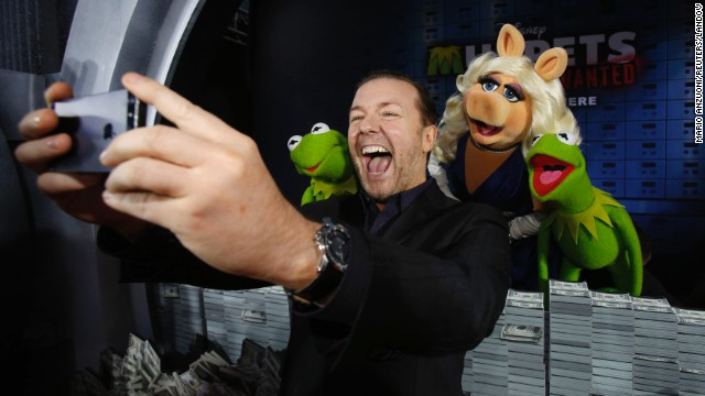 "Actor Ricky Gervais takes a selfie with some of his ""Muppets Most Wanted"" co-stars at the movie's premiere Tuesday, March 11, in Hollywood."