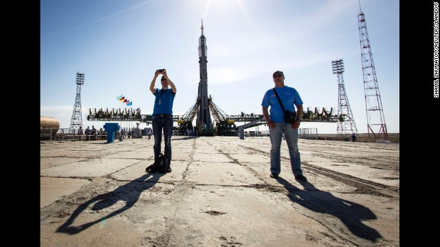 The Soyuz TMA-13M spacecraft is seen behind a man taking a selfie Monday, May 26, at the Baikonur Cosmodrome in Kazakhstan. The Soyuz launched three men to the International Space Station.