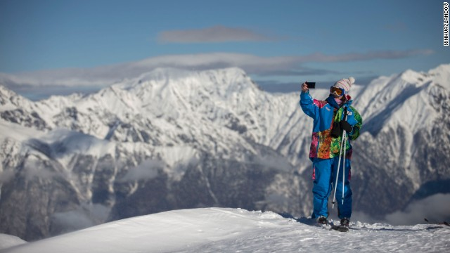 A skier takes a selfie atop Aibga Ridge in Sochi, Russia, on Wednesday, February 5. Sochi hosted the Winter Olympics later that month. <a href='http://www.cnn.com/2014/02/08/worldsport/gallery/visions-of-sochi/index.html'>See more photos from the Winter Olympics</a>