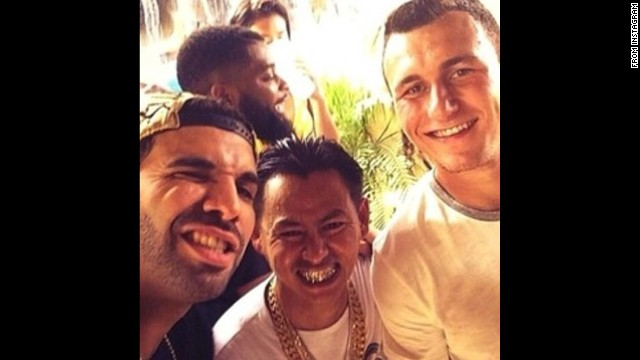 "Rapper Drake, left, <a href='http://instagram.com/p/pQcF4rjQJL/' target='_blank'>snaps a photo</a> with football star Johnny Manziel, right, on Sunday, June 15. ""Aggie life,"" he wrote, referring to Manziel's school, Texas A&M."