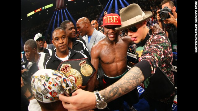 Boxing champion Floyd Mayweather Jr. poses with pop star Justin Bieber after defeating Marcos Maidana in Las Vegas on Saturday, May 3.
