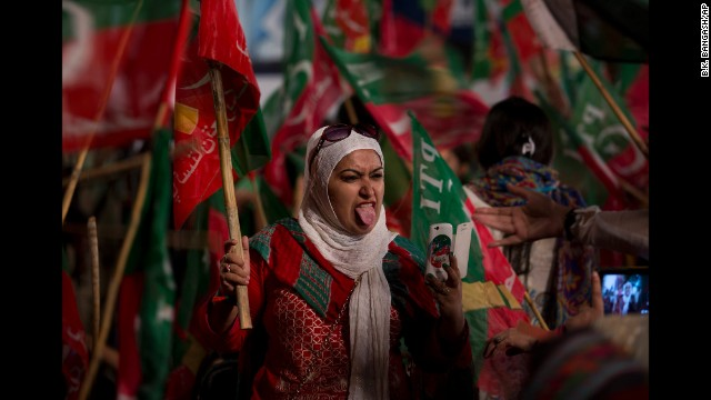A supporter of Pakistani politician Imran Khan sticks out her tongue while taking a selfie during a rally in Islamabad, Pakistan, on Saturday, August 23.