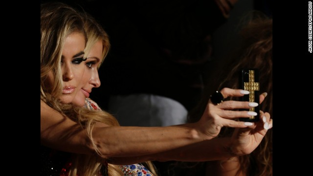 Actress Carmen Electra, left, and socialite Paris Hilton pose for a selfie Wednesday, September 10, during The Blonds collection show at <a href='http://www.cnn.com/2014/09/04/living/gallery/nyfw-runway-spring-2015/'>New York Fashion Week</a>.