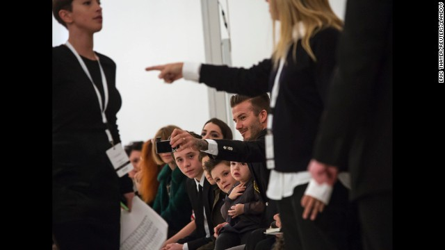 Former <a href='http://www.cnn.com/2013/02/01/showbiz/gallery/david-beckham-through-years/index.html'>soccer star David Beckham</a> takes a selfie with his children before his wife's fashion show in New York on Sunday, February 9.