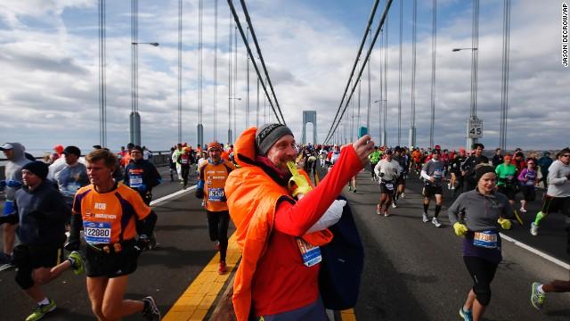 A runner stops to take a selfie Sunday, November 2, as he crosses the Verrazano-Narrows Bridge at the start of the New York City Marathon.