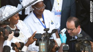 French President Francois Hollande has his temperature taken as he arrives at the Donka hospital in Conakry, Guinea, on Friday November 28. Hollande is visiting the Ebola-stricken country during a seven-hour stop on his way to Dakar, Senegal,