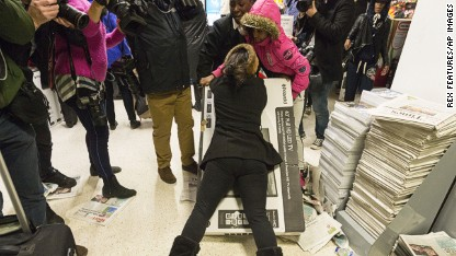 Injuries as 'Black Friday' spreads to UK