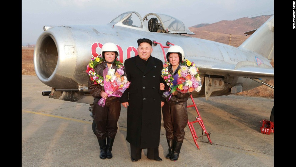 "In an undated photo released on November 28, North Korea leader Kim Jong Un is seen on a field trip to see the airwomen of the KPA Air and Anti-Air Force. North Korean Newspaper Rodong Sinmun reported Kim ""guided a flight drill of pursuit airwomen of the KPA Air and Anti-Air Force. He went out to an airport's runway to learn about the plan for solo take-off and landing drill by women pilots of pursuit planes and guide their flight."""