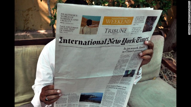 <strong>March 24:</strong> A man reads a copy of the International New York Times at an office in Karachi, Pakistan. The New York Times said <a href='http://www.nytimes.com/2014/03/23/business/media/times-report-on-al-qaeda-is-censored-in-pakistan.html' target='_blank'>an article about Pakistan's relationship to al Qaeda was censored</a> by its local distributor in the country, leaving a blank space on its weekend edition.