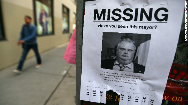 "<strong>May 7:</strong> Toronto Mayor Rob Ford is seen on a mock ""missing person"" poster in Toronto. Hours after a local newspaper <a href='http://www.cnn.com/2013/11/15/politics/gallery/rob-ford-controversy/index.html'>reported on a new video that allegedly showed Ford smoking crack cocaine,</a> the mayor announced that he would be taking a break from his duties and his re-election campaign to seek help for alcohol abuse. Later in the year, after the discovery of an abdominal tumor, <a href='http://www.cnn.com/2014/09/12/world/toronto-mayor-ford-withdraws/'>he decided not to seek re-election.</a>"