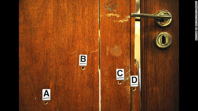 <strong>April 14:</strong> The door through which Oscar Pistorius fatally shot his girlfriend, Reeva Steenkamp, is used as evidence during his murder trial in Pretoria, South Africa. Pistorius, the first double-amputee runner to compete in the Olympics, was <a href='http://www.cnn.com/2014/03/03/africa/gallery/pistorius-2014-trial/index.html'>found guilty of culpable homicide</a> -- the South African term for unintentionally, but unlawfully, killing a person. He was sentenced to five years in prison.
