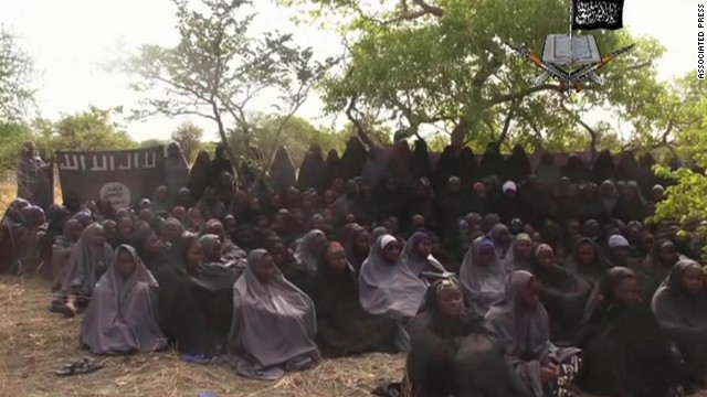 "<strong>May 12:</strong> This image, taken from video shot by Boko Haram militants, allegedly shows the Nigerian schoolgirls that the group abducted in April. More than 200 girls were taken, <a href='http://www.cnn.com/2014/05/01/world/gallery/nigeria-girls-kidnapped/index.html'>sparking a global outcry.</a> The Islamist militant group, whose name means ""Western education is sin,"" <a href='http://www.cnn.com/2014/12/01/world/africa/nigeria-boko-haram-attack/index.html'>later said it sold most of the girls into slavery.</a>"