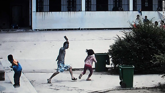 <strong>May 20:</strong> This picture, taken from security camera video, shows a knife-wielding attacker going on a rampage at a primary school in Macheng, China. Eight students were injured in the attack, <a href='http://www.scmp.com/news/china/article/1516758/children-attacked-knifeman-hubei-school' target='_blank'>according to the South China Morning Post</a>.