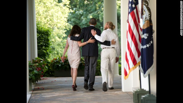 <strong>May 31:</strong> U.S. President Barack Obama, center, walks with the parents of Army Sgt. Bowe Bergdahl after making a statement at the White House about <a href='http://www.cnn.com/2014/05/31/world/asia/afghanistan-bergdahl-release/index.html'>Bergdahl's release.</a> Bergdahl had been held captive in Afghanistan for nearly five years, and the Taliban released him in exchange for five U.S.-held prisoners.