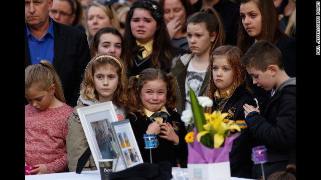 <strong>July 20:</strong> Mourners in Eynesbury, Australia, attend a memorial service for a family of five killed aboard Malaysia Airlines Flight 17. Johannes van den Hende, Shalize Zain Dewa and their children -- Piers, Marnix and Margaux -- were on the passenger plane when it was shot down.