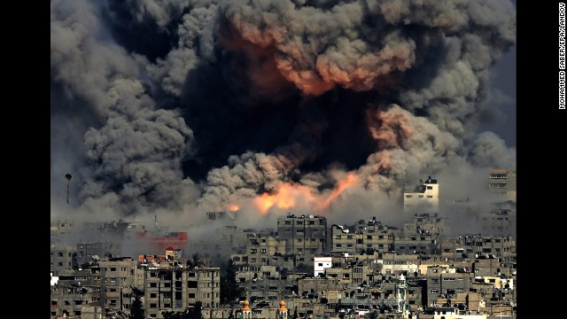 <strong>July 29:</strong> Smoke rises in Gaza City after Israeli airstrikes. Israel <a href='http://www.cnn.com/2014/07/18/world/gallery/israel-gaza/index.html'>launched a ground operation in Gaza</a> after a 10-day campaign of airstrikes failed to halt relentless Hamas rocket fire on Israeli cities. After more than seven weeks of heavy fighting, Israel and Hamas agreed to an open-ended ceasefire that put off dealing with core long-term issues.