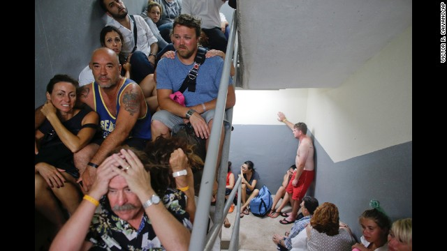 <strong>September 15:</strong> Tourists sit in a stairwell of a Los Cabos, Mexico, resort after the resort's designated shelter was <a href=