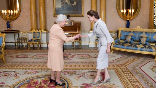 <strong>October 10:</strong> Actress Angelina Jolie, right, is presented with an honorary damehood by Britain's Queen Elizabeth II at London's Buckingham Palace. <a href='http://www.cnn.com/2014/10/10/showbiz/britain-angelina-jolie/'>Jolie was recognized</a> for her campaign to end sexual violence in war zones. <a href='http://www.cnn.com/2013/05/14/showbiz/gallery/angelina-jolie/index.html'>See more photos of Jolie's life and career</a>