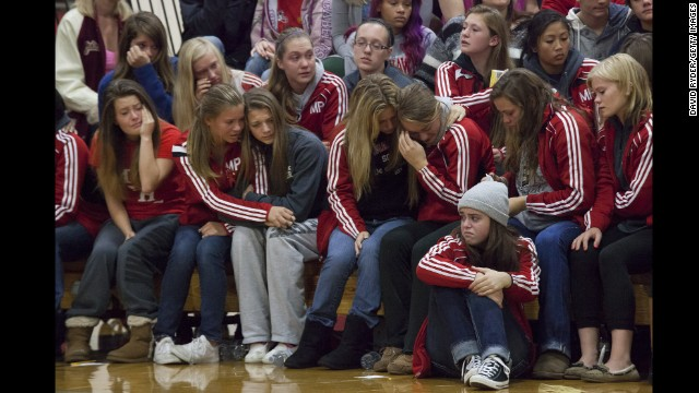 <strong>October 26: </strong>Students grieve during a gathering at Marysville-Pilchuck High School in Marysville, Washington. Law enforcement officials say Jaylen Fryberg, a popular freshman at the school, <a href='http://ift.tt/1yvbYBD'>shot five fellow students</a> before committing suicide on October 24.