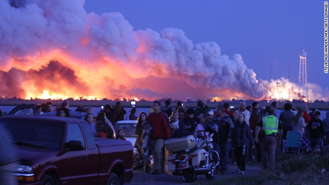 <strong>October 28:</strong> People who came to Wallops Island, Virginia, to watch the launch of a NASA-contracted rocket walk away after <a href='http://www.cnn.com/2014/10/29/us/gallery/antares-explosion/index.html'>the unmanned spacecraft, owned by Orbital Sciences Corp., exploded.</a> The cargo module was carrying 5,000 pounds of supplies and experiments meant for the International Space Station. No one was injured in the explosion, and the cause is under investigation.