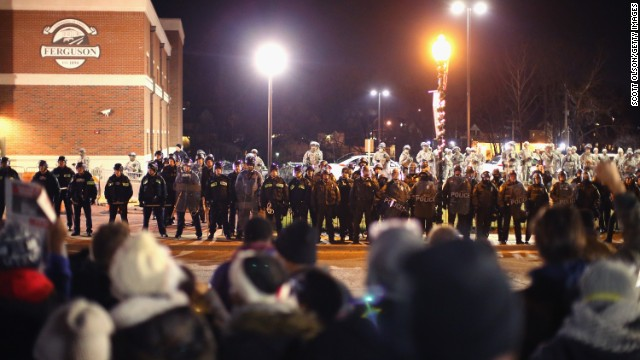 Police confront demonstrators outside the police station in Ferguson, Missouri, on Friday, November 28.