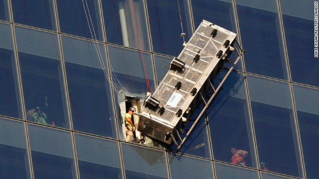 <strong>November 12:</strong> New York emergency crews rescue <a href='http://ift.tt/14em3JH'>two workers who were trapped on a window-washing scaffold</a> that was dangling at the 69th floor of the One World Trade Center building.