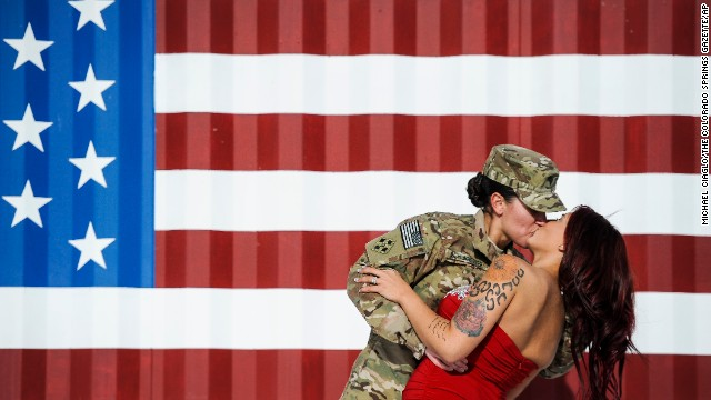 <strong>November 14:</strong> U.S. Army Spc. Sabryna Schlagetter kisses her wife, Cheyenne, after returning home to Fort Carson, Colorado, with other members of the 4th Infantry Brigade Combat Team. The couple married on Valentine's Day this year before Sabryna deployed to Afghanistan.