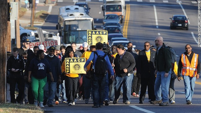 "Members of the NAACP and other demonstrators march up Chambers Avenue in Ferguson, Missouri, on Saturday, November 29. The NAACP has organized a ""Journey of Justice"" march from Ferguson, Missouri, to the Missouri governor's residence in Jefferson City over the next seven days, a march of 120 miles."